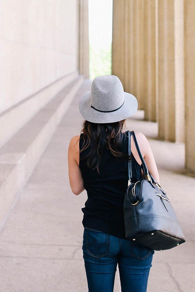 An image of a student at university, walking along a path